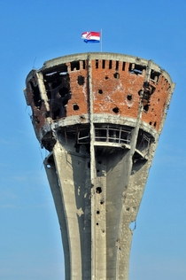 The Vukovar water tower Heavily damaged in the Battle of Vukovar the tower has been preserved as a symbol of the conflict Photo by anji on flickr