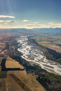 The Waimakariri River Canterbury New Zealand braiding its way to the Pacific Ocean from the mountains