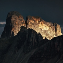 The Wall Dramatic light on a peak in the Dolomites shortly before a thunderstorm  Photo by Kilian Schnberger