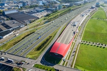 The Wall  meter long combination of sound barrier and business complex with a parking on top A Utrecht Leidsche Rijn The Netherlands