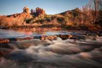 The warm glow of the setting sun illuminates Cathedral Rock - Sedona Arizona