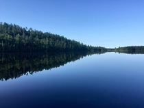 The water is so calm and reflective that honestly I could have posted this photo upside down and youd never know Lake Temagami ON Canada