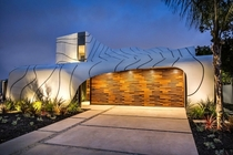 The Wave House by artist designer and builder Mario Romano in Venice California The rippling facade is made up of hundreds of individual aluminum panels