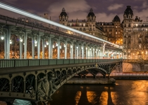 The western part of the Pont de Bir-Hakeim seen at nightwith buildings of the th arrondissement of Paris visible in the background