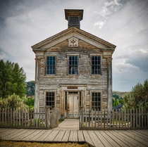 The western United States landscape is dotted with abandoned towns This schoolhouseMasonic meetinghouse is one of the few preserved buildings in the ghost town of BannackMT