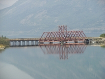 The White Pass and Yukon Route rail bridge over the strait between Bennett Lake and Nares Lake in Carcross