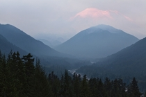 The wildfires currently burning in Washington have created so much smoke Mount Rainier isnt visible until the sun lights in up in the morning But when it appears