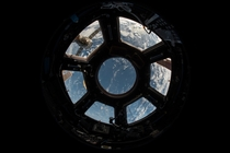 The windows of the International Space Station are registered by a fisheye lens in a photo taken by members of Expedition   StationCDRKelly  Twitter