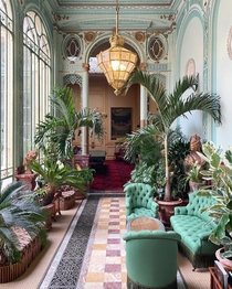 The Winter Garden inside the Htel de la Pava a large th century townhouse that has been used as a gentlemens club for more than a century Avenue des Champs-lyses Paris France