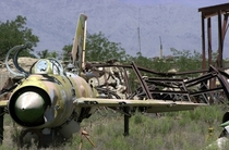 The wreckage of an abandoned Soviet Mig- Fishbed aircraft sits with rusted hardware in an open field near Bagram Air Base Afghanistan