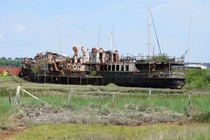 The wrecked and abandoned PS Ryde sitting on the banks of the River Medina Isle Of Wight Efforts to restore her in  failed and sadly she will be left to rust away