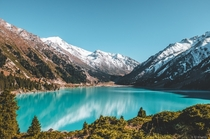 Theres a beautiful lake in Alberta Canada thats heavily photographed Im sorry to inform you this isnt that lake Big Almaty Lake in Kazakhstan