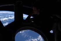 Theres no place like home Peering out of the windows of the International Space Station astronaut Tracy Caldwell Dyson takes in the planet on which we were all born and to which she would soon return About  km up the ISS is high enough so that the Earths