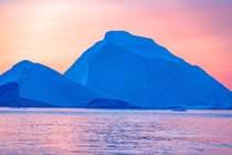 These are actually two icebergs that transformed into a brilliant blue shade as the light changed that evening in Ilulissat Greenland
