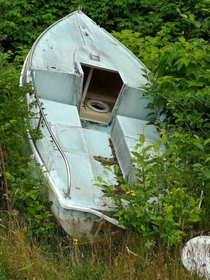 This abandoned speed boat with a toilet