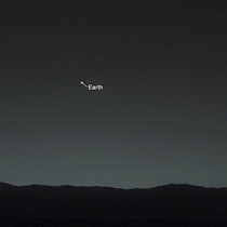 This amazing photo was actually taken from Mars Yup the planet Mars and that tiny star-like white dot there is our beloved Earth