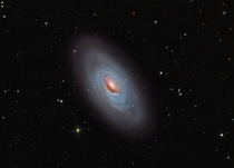 This beautiful bright spiral galaxy is Messier  often called the Black Eye Galaxy or the Sleeping Beauty Galaxy for its heavy-lidded appearance in telescopic views M is about  million light-years distant in the otherwise well-groomed northern constellatio