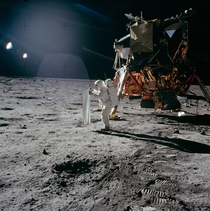 This bright sunlight glints amp long dark shadows marks of lunar surface is taken by Apollo  astronaut Neil Armstrong in July   In the image the spacesuited lunar module pilot Buzz Aldrin is unfurling a long sheet of foil known as solar wind composition e