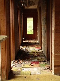 This colorful carpet was made of small squares of sample carpets stitched together The house caved in a few years ago and is no longer accessible Great Smoky Mountains National Park Tennessee