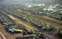 This eerie photo of the unusable highly contaminated abandoned vehicles that were used to cleanup the reactor  blast at Chernobyl over the years most of these were eventually buried deep in the ground