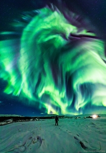 This enthralling dragon aurora appeared in the sky over Iceland The person captured in the foreground is the photographers mother Credit Jingyi Zhang amp Wang Zhang