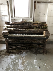 This frozen piano made from branches