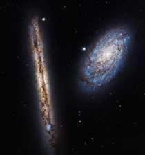 This Hubble image marking the th anniversary of the space telescopes launch features the edge-on spiral galaxy NGC  and the tilted galaxy NGC  Theyre both about  million light-years away both part of the Virgo Cluster in the constellation Coma Berenices