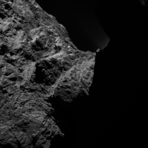 This image of comet PChuryumov-Gerasimenko was obtained on October   by the OSIRIS scientific imaging system on the Rosetta spacecraft The right half is obscured by darkness The image was taken from a distance of approximately  miles