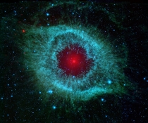 This infrared image from NASAs Spitzer Space Telescope shows the Helix Nebula a cosmic starlet often photographed by amateur astronomers for its vivid colors and eerie resemblance to a giant eye