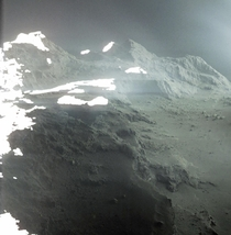 This is a landscape on Comet P The cliffs in the foreground are  meters high