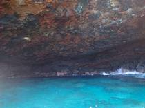This is a small cave that was created from lava rock being eroded by the waves near Kealakekua Bay HI
