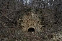 This is an old limestone kiln in Pike County Illinois Its listed on the National Register of Historic Places Its not easy to find and is completely overgrown this time of year I shot this last winter x