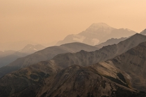 This is not Mars These are mountains in Jasper Canada Earth under a cloud of smoke caused by the wildfires raging on the US West coast