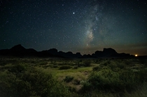 This is taken during that rare few minutes when the waxing crescent moon is visible at the same time as the Milky Way Big Bend National Park