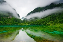 This is the other China High in the mountains of the Jiuzhaigou Nature Reserve visitors have discovered the sapphire-and-emerald-tinted waters of Five Colored Lake far removed from the industrial sprawl that consumes lives below  Photo by Michael S Yamash