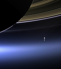 This is what Earth looks like from  billion kilometers away the Cassini spacecraft spots a pale blue dot beneath Saturns rings