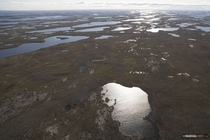 This is what the arctic regions of Canada looks like from a helicopter in summer Shot in Nunavut Canada