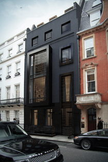This London house got a contemporary upgrade when it changed its vintage brick color palette for a dramatic black external