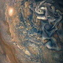This looks like an abstract painting but its actually a picture of Jupiters clouds taken by Juno in