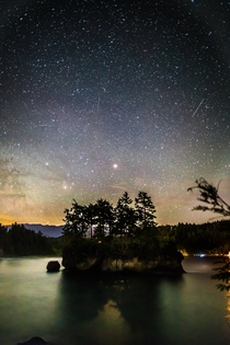 This lovely island captured my attention for most of the night Here is Mars rising over the Salt Creek Campgrounds in Washington State