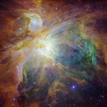 This masterpiece shows the Orion nebula in an explosion of infrared ultraviolet and visible-light colors It was painted by hundreds of baby stars on a canvas of gas and dust with intense ultraviolet light and strong stellar winds as brushes