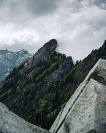 This mountain holding back clouds on a rainy day in the Alpine Lakes Wilderness WA