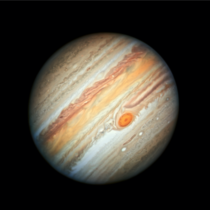 This new Hubble Space Telescope view of Jupiter taken on June   reveals the giant planets trademark Great Red Spot and a more intense color palette in the clouds swirling in Jupiters turbulent atmosphere than seen in previous years