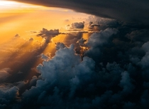 This picture is taken as our plane passed through a thunderstorm The sunset was timed perfectly and left a divine aura around the plane part  Photo taken by Tom Barrett