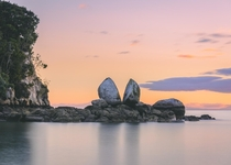 This rock in New Zealand is naturally split this way Tokangawh also known as Split Apple Rock at Sunrise