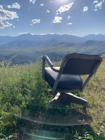 This single rusted chair abandoned on the top of a mountain Interesting find at the end of my hike