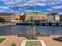 This statue of Apollo the Greek god of the sun poetry and music appears to be flashing the city of Stockholm Sweden because he is naked except for his helmet