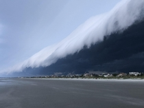 this tsunami-like cloud over the beach