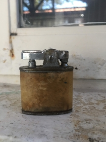 This very old lighter I found inside an abandoned grandpas tools chest