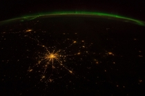 This view of the Aurora Borealis was photographed from the International Space Station by an astronaut orbiting over Russia -- latitude  longitude  -- on  October  at  GMT